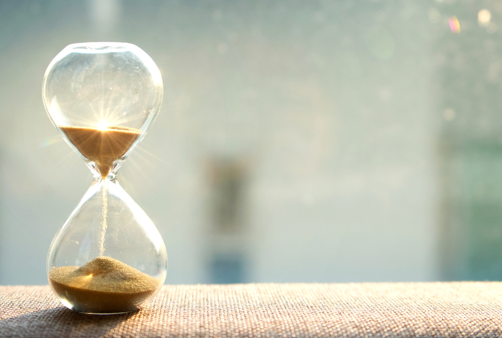Life,Time,Passing,Concept.,Hourglass,With,Sun,Light,Background