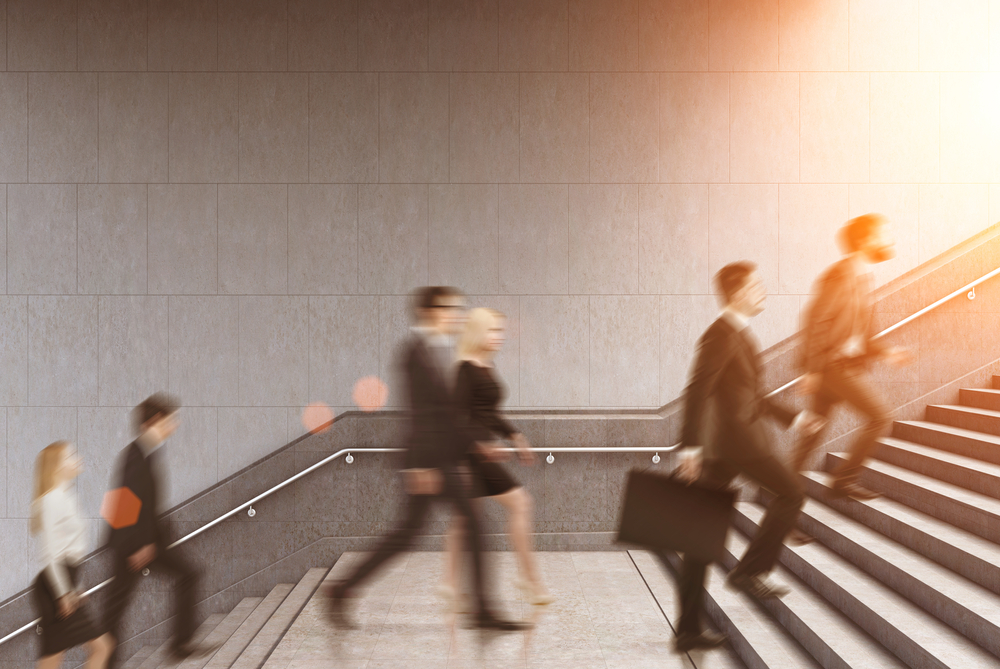 Side,View,Of,Business,People,Climbing,A,Stair,In,A